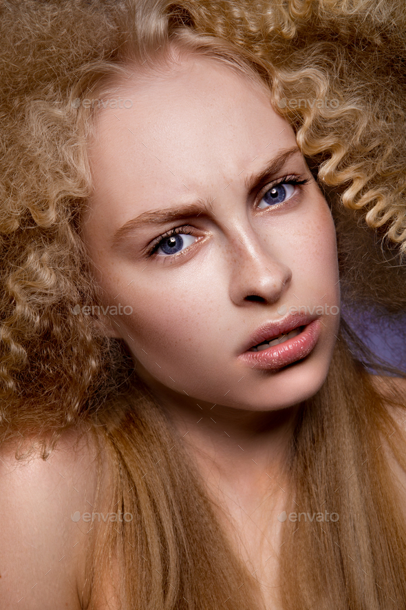 Beautiful blonde model girl with long curly hair .  - Stock Photo - Images