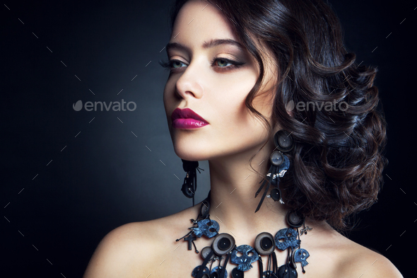 Close-up studio portrait of beautiful woman. - Stock Photo - Images