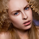 Beautiful blonde model girl with long curly hair .  - PhotoDune Item for Sale