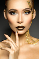 Beautyful girl with gold glitter on her face and body - PhotoDune Item for Sale