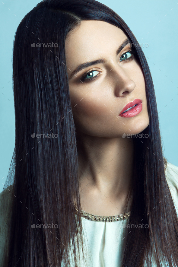 Beautiful young woman with long straight hair - Stock Photo - Images