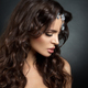Beautiful brunette model with long curly brown hair. - PhotoDune Item for Sale