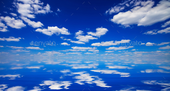 sky and clouds reflected in water - Stock Photo - Images