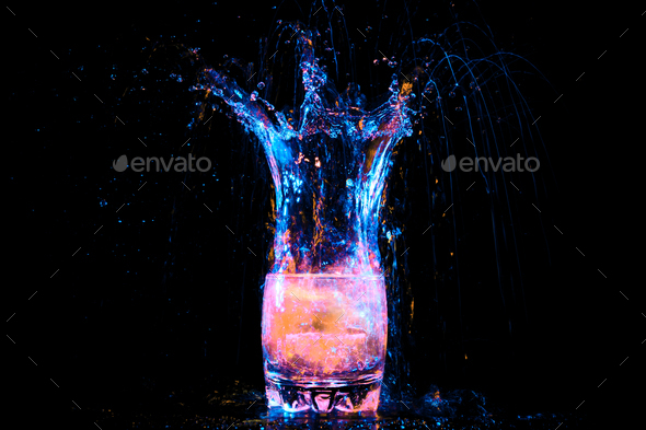 cocktail in glass with splashes - Stock Photo - Images