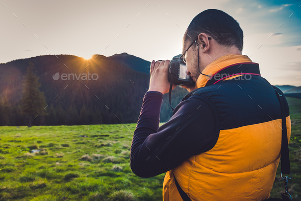 Nature photographer tourist in mountains - Stock Photo - Images