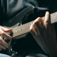 Fingers of Guitarist at the Strings. Mens Arms Plays Solo of Rock Music. Hands of Male Musician - VideoHive Item for Sale