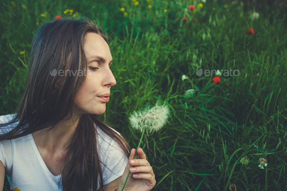 Allergy free concept. Woman blowing dandelion - Stock Photo - Images
