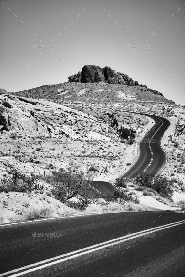 Black and white picture of a scenic desert road. - Stock Photo - Images