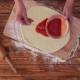 Top View Video of Woman Is Adding Tomato Sauce To Pizza Base - VideoHive Item for Sale