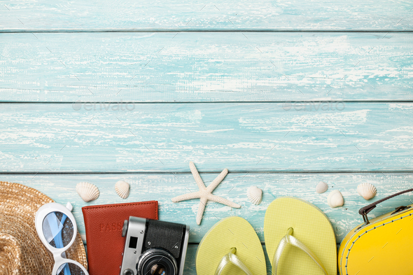 Vacation beach accessories and seashells on blue background - Stock Photo - Images