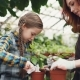 Caring Mother Professional Gardener Is Teaching Her Daughter To Hoe Soil in Plant Pot with Small - VideoHive Item for Sale