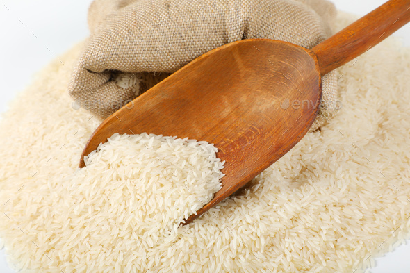 long grained rice, wooden scoop and burlap bag - Stock Photo - Images