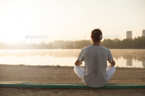 Shot of healthy young man taking a break after morning workout. - Stock Photo - Images