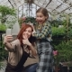 Loving Mother and Playful Daughter Are Taking Selfie in Greenhouse Posing, Gesturing and Making - VideoHive Item for Sale