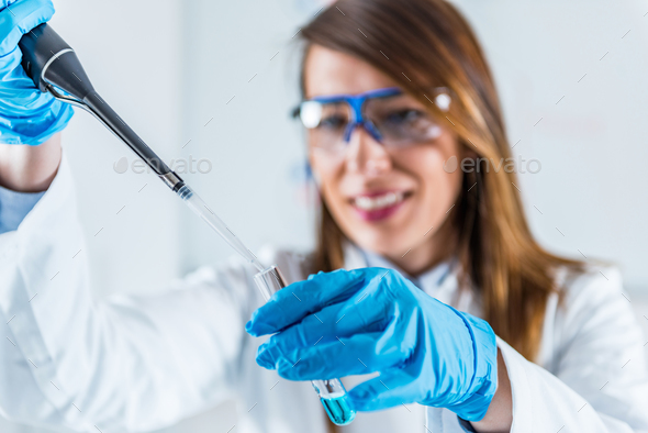Using micro pipette - Stock Photo - Images