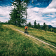 Mountain biking man riding in woods and mountains - PhotoDune Item for Sale