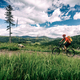 Mountain biker cycling riding in woods and mountains - PhotoDune Item for Sale
