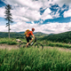 Mountain biker cycling riding bikepacking in woods and mountains - PhotoDune Item for Sale