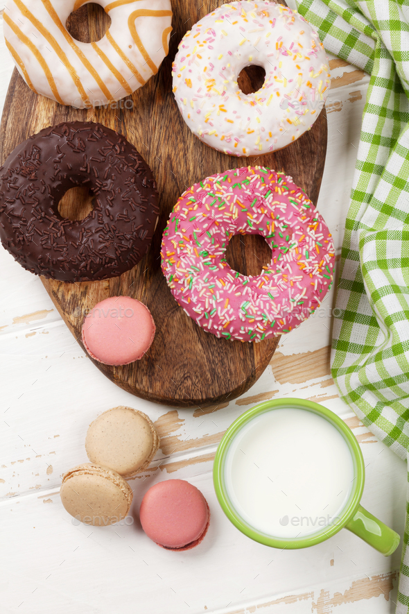 Milk and donuts on wooden table - Stock Photo - Images