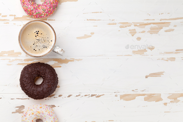 Coffee cup and donuts - Stock Photo - Images