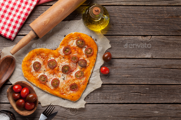 Heart shaped pizza with tomatoes and mozzarella - Stock Photo - Images