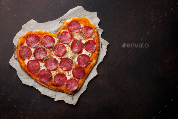 Heart shaped pizza with pepperoni - Stock Photo - Images