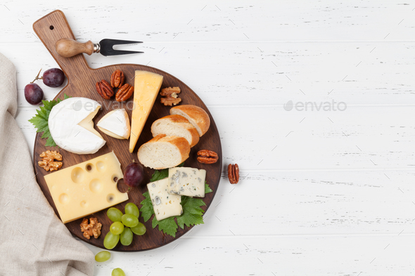 Cheese plate with grapes and nuts - Stock Photo - Images