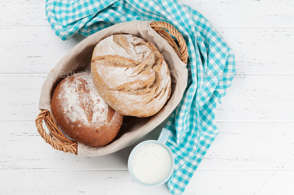 Homemade crusty bread and milk - Stock Photo - Images