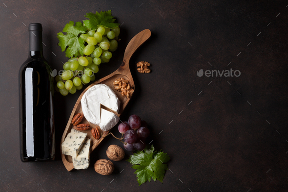Wine bottle, grape and cheese - Stock Photo - Images