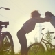 Girls-cyclists Keep Each Other and Warm Up in Pakr, Next To Their Bicycles, Summer Sunny Day - VideoHive Item for Sale