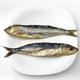 two salt herring sardines, ordered in white dish - PhotoDune Item for Sale