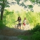 A Bike Ride in the Forest, Two Girlfriends of the Cyclist Have Fun Communicating and Climb From the - VideoHive Item for Sale
