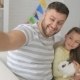 Happy Father with Two Children and a Rabbit Makes a Selfie - VideoHive Item for Sale