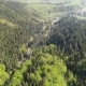 Flight Over the Forest in the Mountains and Village Aerial View of Ukrainian Carpathians - VideoHive Item for Sale