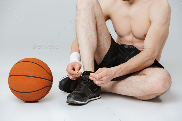 Cropped image of a young half naked sportsman - Stock Photo - Images