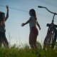 Two Young Girls Warm up and Jump before a Bike Ride - VideoHive Item for Sale