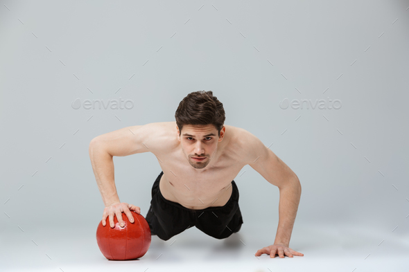 Portrait of a concentrated young half naked sportsman - Stock Photo - Images
