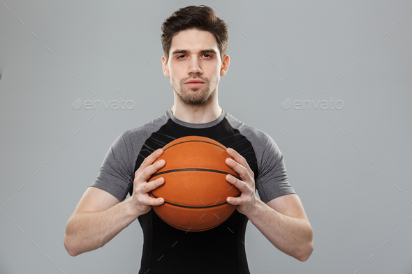Portrait of a concentrated young sportsman - Stock Photo - Images