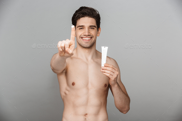 Beauty portrait of half naked confident young man - Stock Photo - Images