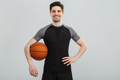 Portrait of a satisfied young sportsman with a basketball - PhotoDune Item for Sale