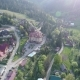 Flight Over the Village in the Ukrainian Carpathians Mountains. Grand Hotel Pylypets Aerial View - VideoHive Item for Sale