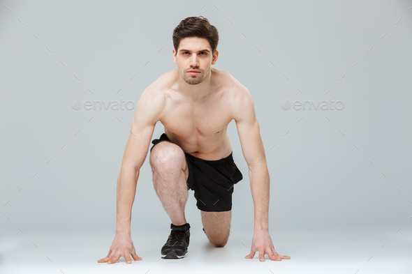 Portrait of a focused young half naked sportsman - Stock Photo - Images
