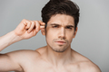 Close up beauty portrait of half naked concentrated young man - PhotoDune Item for Sale