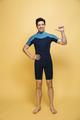 Joyful young man dressed in swimsuit - PhotoDune Item for Sale