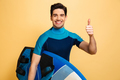 Portrait of a smiling young man dressed in swimsuit - PhotoDune Item for Sale