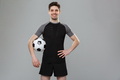 Portrait of a smiling young sportsman with a soccer ball - PhotoDune Item for Sale