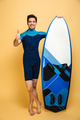 Cheerful young man make thumbs up. - PhotoDune Item for Sale