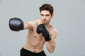 Portrait of a concentrated young sportsman exercising - PhotoDune Item for Sale