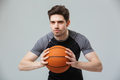 Portrait of a focused young sportsman playing basketball