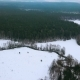 AERIAL: Winter Forest and River. Birds Eye View on Winter Landscape of Snowy Forest and Ribbon-like - VideoHive Item for Sale